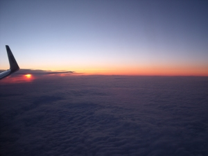 sunrise from a plane, morning skyline in the clouds